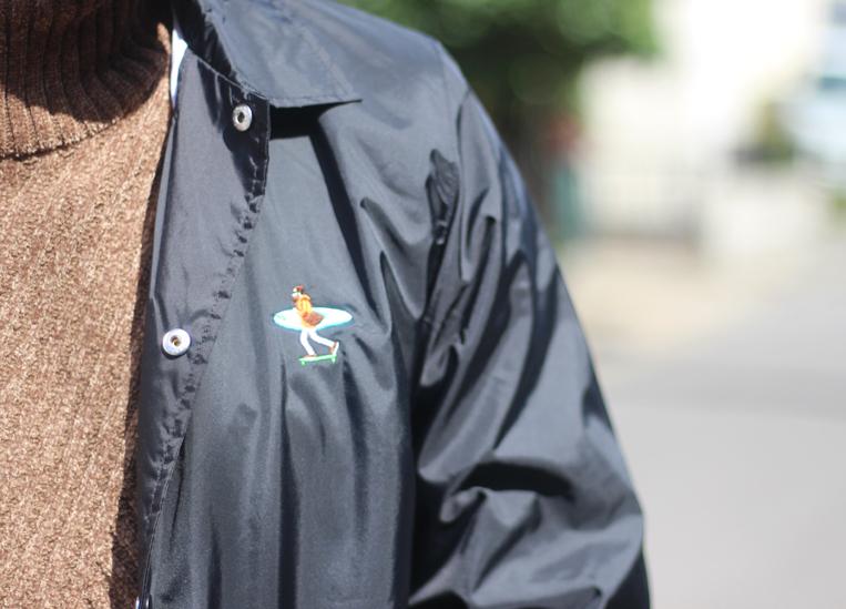 ワンポイント刺繍のコーチジャケット