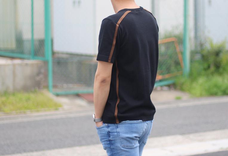 ブラック変えるブラウンのサイドラインニットを着た男性