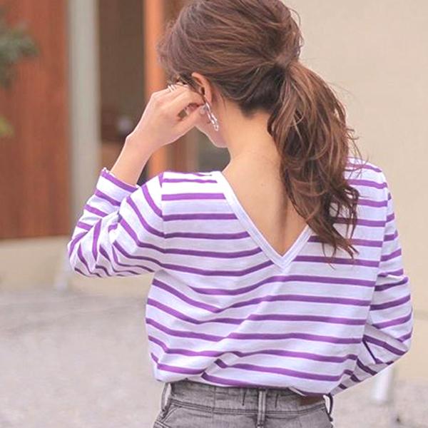 ルミノアのバスクシャツを着た女性